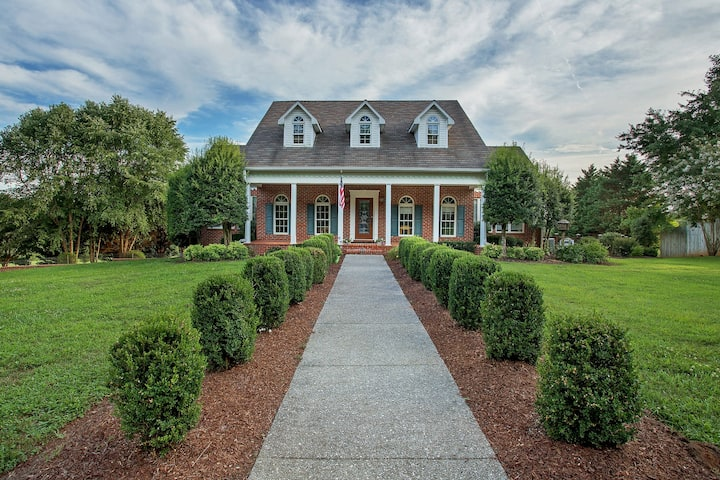Meticulously-maintained estate on 11 private acres w/pool & trails