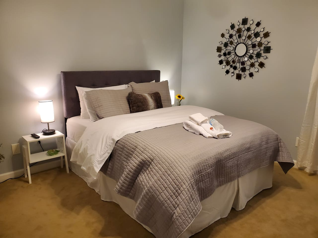 Relax in your newly remodeled room with pillow topped queen bed and plush-down comforter. Side tables feature charging ports and outlets.