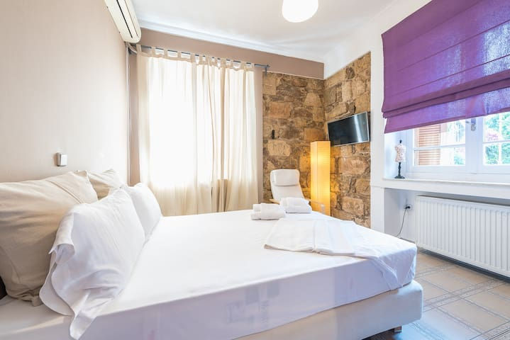 Relax in the sunny and elegant double bedroom after a day of exploring the city