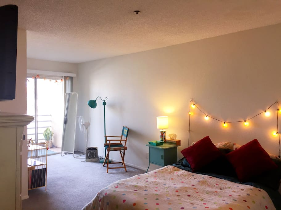 Your Master Suite with private, shaded balcony and view of the Hollywood Hills... Has its own TV for DVDs ~