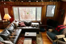 Living room with large comfy sectional sofa.  View from the spacious loft