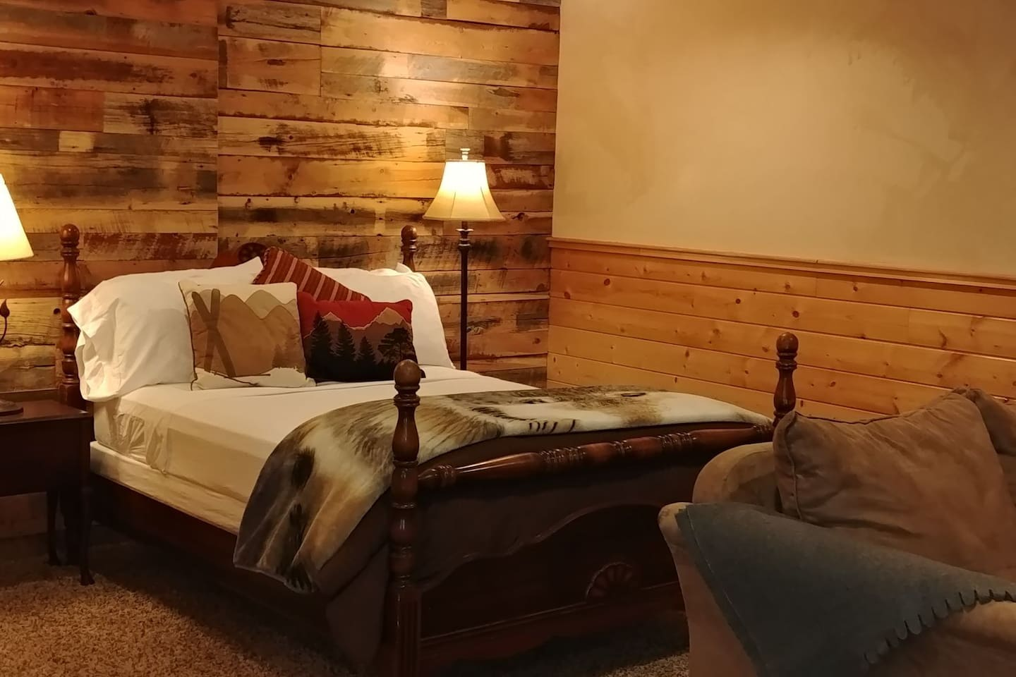 Double bed with two reading lamps.