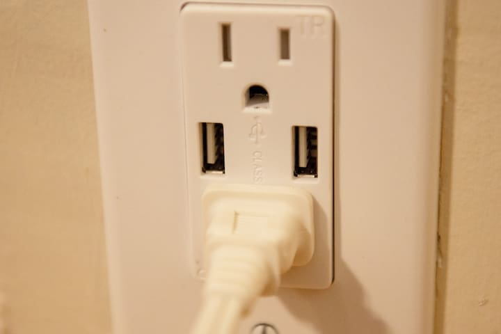 USB plugs beside your bed for easy overnight charging.