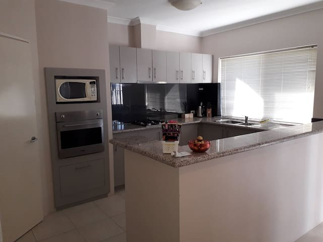 Spacious kitchen with oven, microwave, fridge/freezer, walk in pantry, tea/coffee facilities, toaster, crockery and glassware for 6. All brand new!