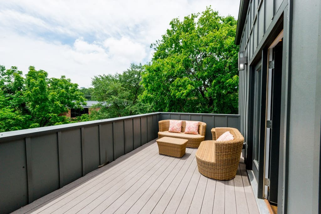 Step out onto the expansive third-story deck to enjoy social time with a tree-top view