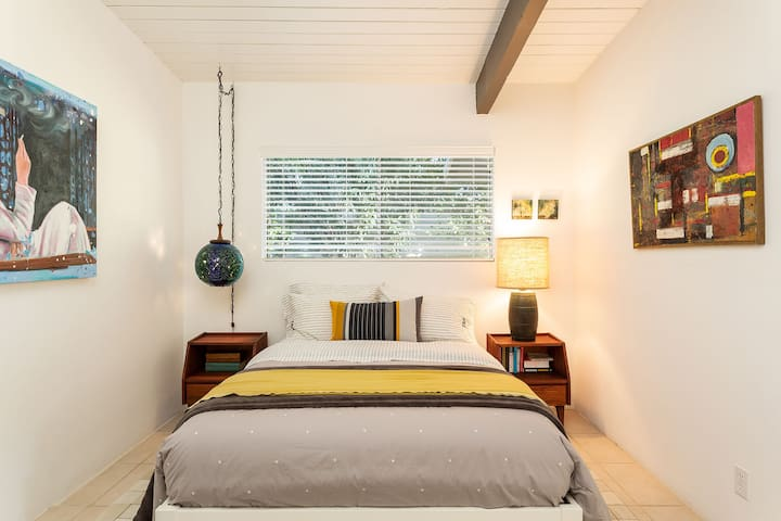 garden side guest bedroom with double bed