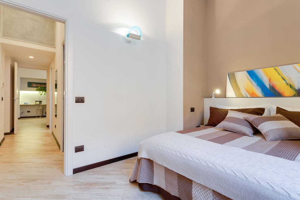 double bed room A light brown shade placed over an understated grey undertone on one wall makes the room intimate and relaxing