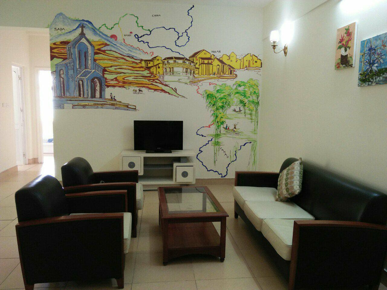 elegant living room with beautiful wall pictures of beautiful lanscapes in Vietnam