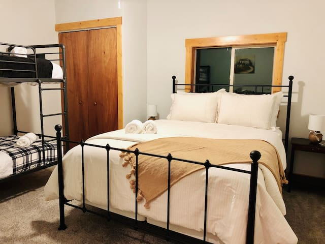 The third bedroom provides comfortable beds and closet space.