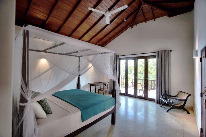 Airy bedroom opening onto veranda