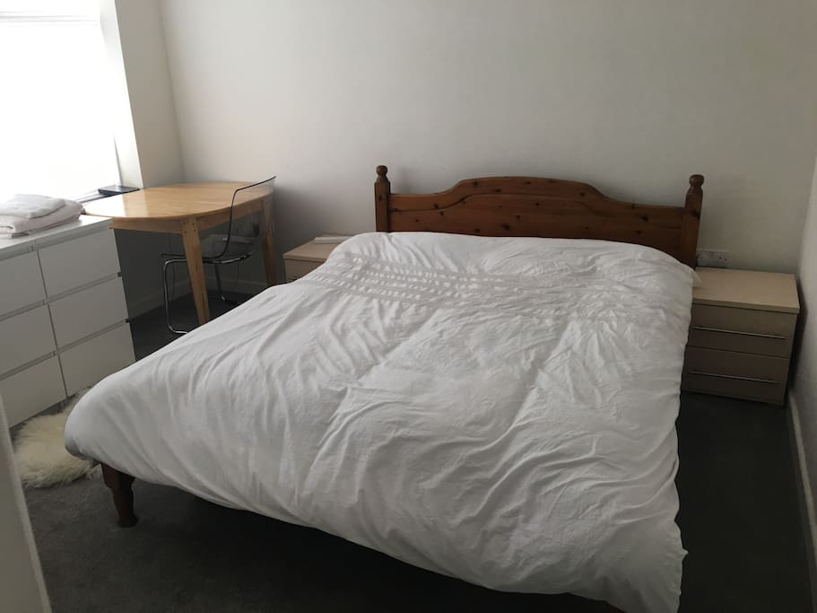 Triple room with super king size bed and extra single bed. Or can be used as 3 single beds. Desk and one chair. Wardrobe, Coat rack & chest fo drawers. Juliet balcony with view of back garden.