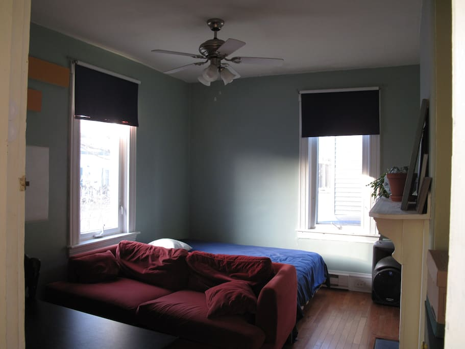 Spacious room with lots of light, hardwood floors and desk