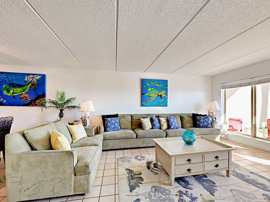 The condo features a poolside patio, nautical-inspired design elements, and tile flooring throughout.