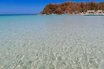 Shallow water.. you can walk far. Crystal clear. It's not just beautiful. It's so beautiful that you would not want to leave...