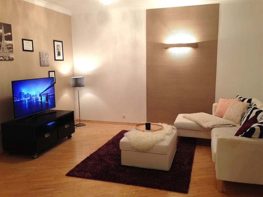 living room with flatscreen, DVD recorder and movies
