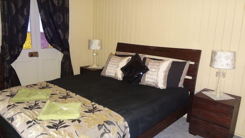 Queen Bedroom with Ceiling Fans