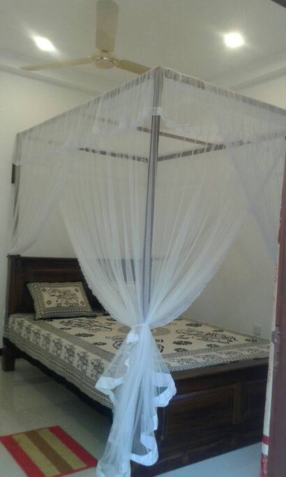 Queen size bed with mosquito net