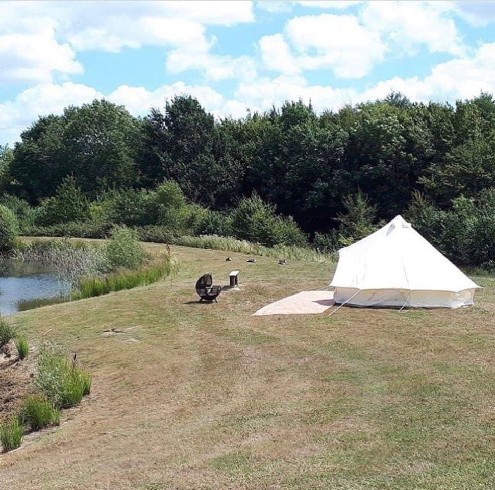 A bell tent over looking one of the carp lakes available to fish and enjoy.