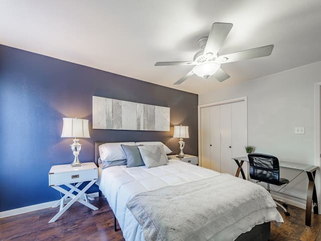 bedroom has a work space to plug in your laptop or do your makeup!
