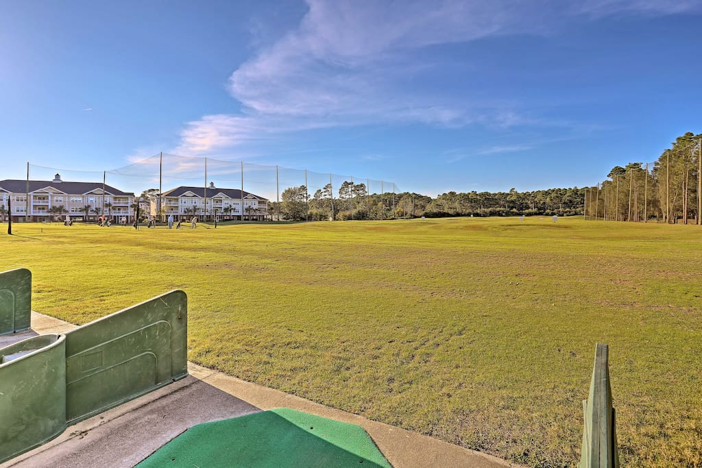 Boost your golf skills at the community driving range before a night out in Myrtle Beach - just 15 minutes north of this home.