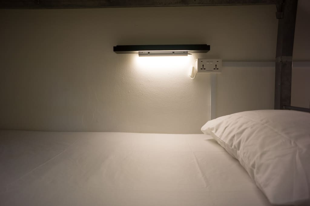 Individual reading light and shelves