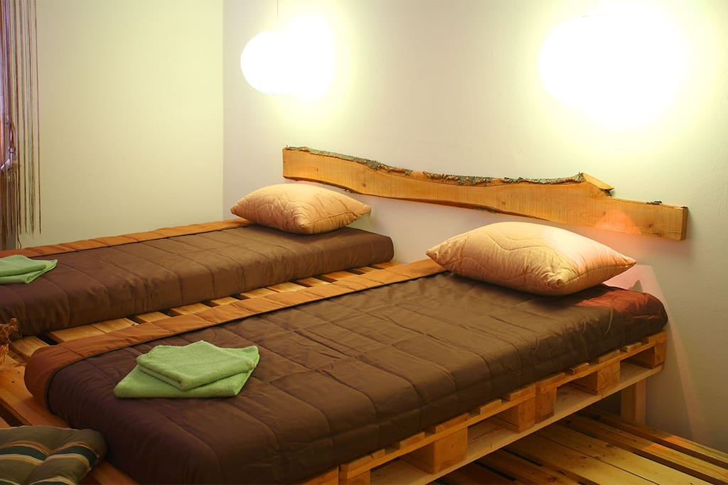 Big rustic handmade double bed splits in two single beds