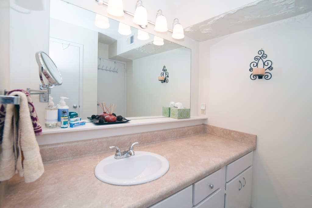 Your master bathroom is attached to the bedroom en suite & offers a large sink area and makeup mirror separated from the shower.