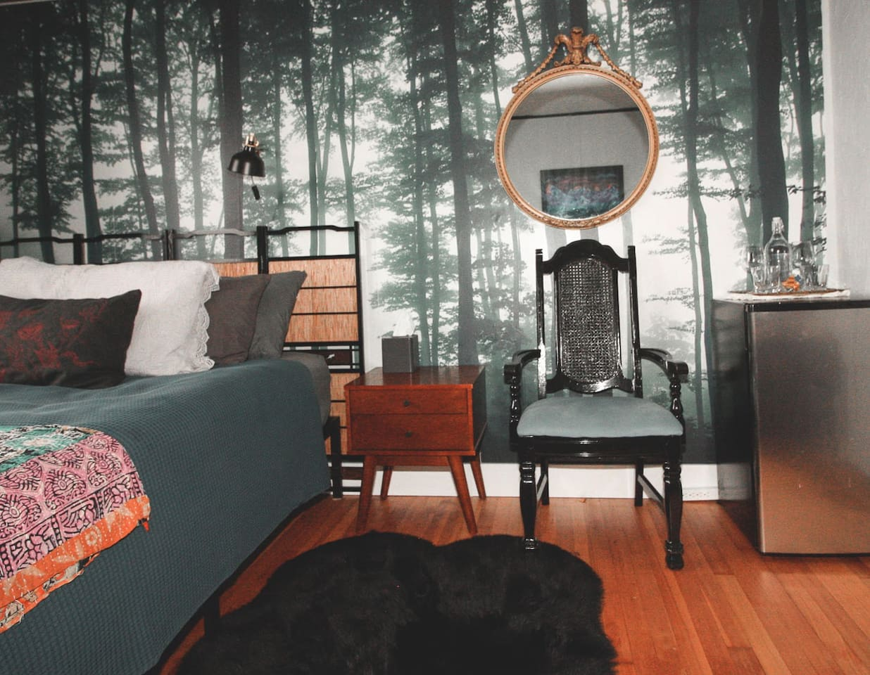 This room has a mini-fridge with lots of details including a gorgeous faux fur rug.