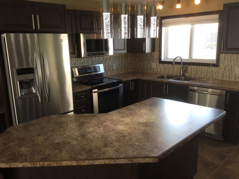 stainless steel appliances with plenty of cabinets and storage