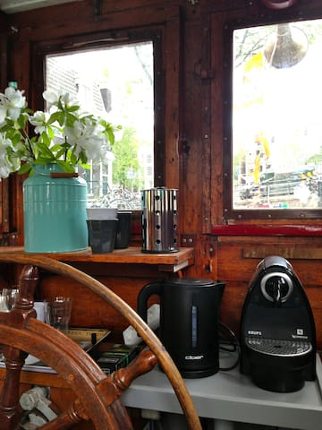 The upstairs rudder room, where you can enjoy your drink with a view on the canal
