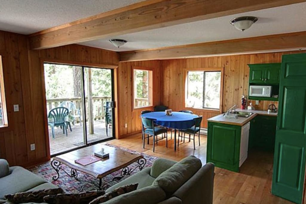 Bright, spacious living area and a private hot tub on the deck