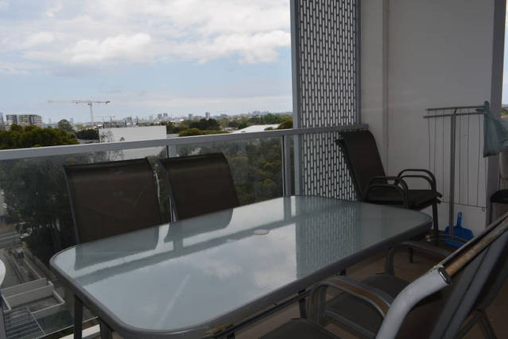 Spacious balcony with dinning table to enjoy your meals in the nice Sydney weather