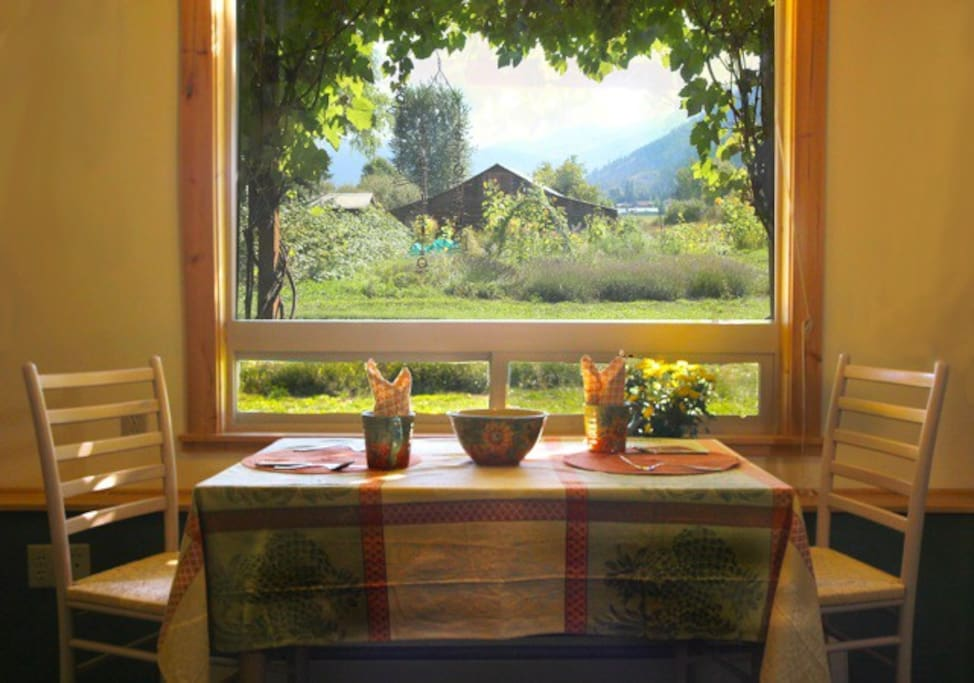 View of garden and mountains from dining table.