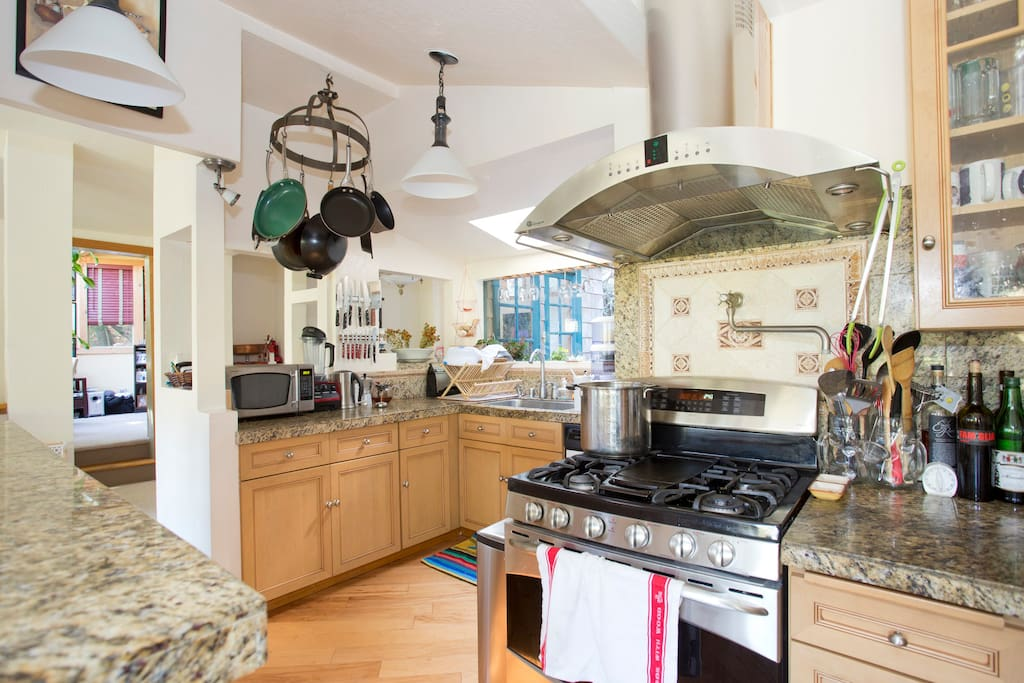Nice gas range and very well stocked kitchen are a chef's dream.  You might think about going out for dinner but change your mind and stay in.