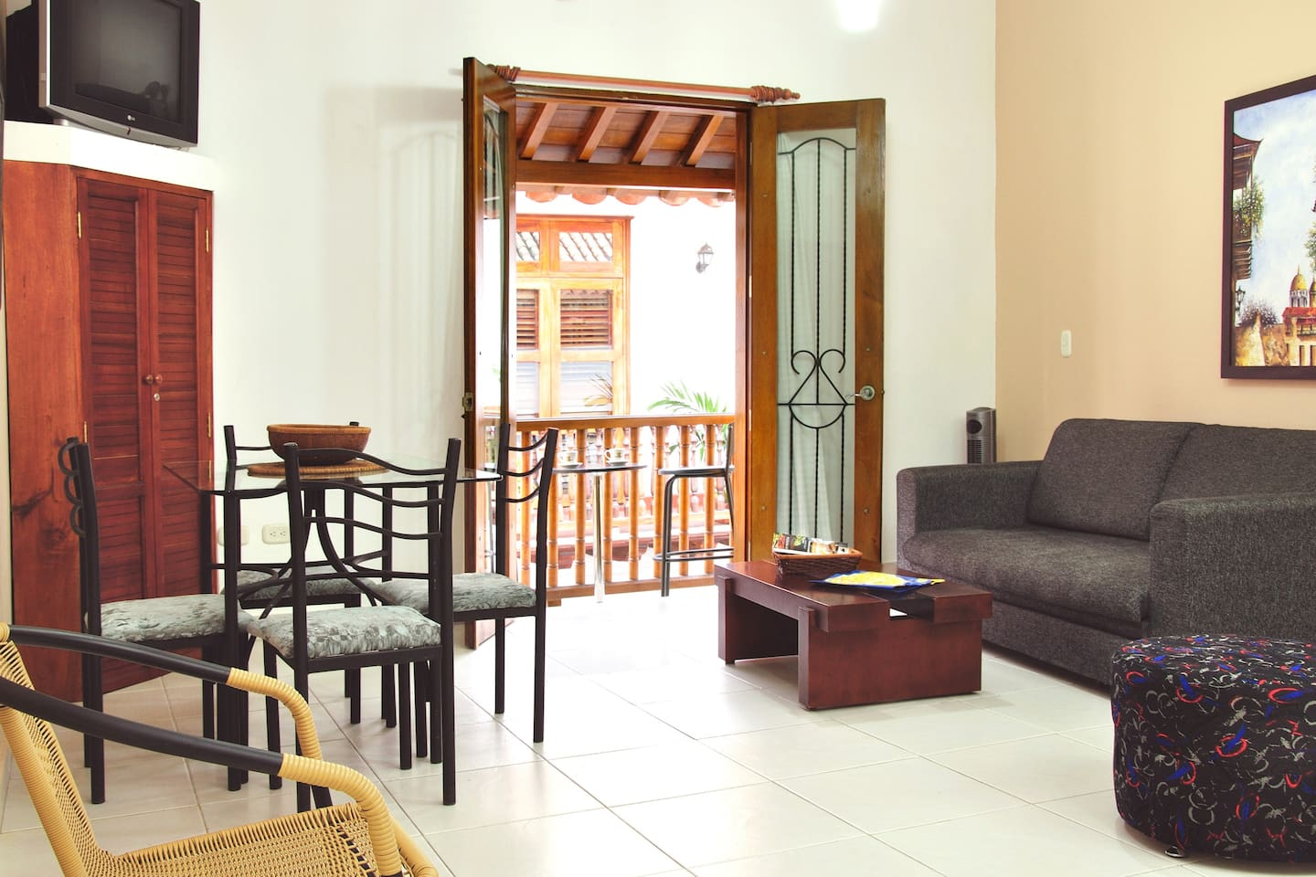 Enter your apartment into the dining and living area (with sleeper sofa).