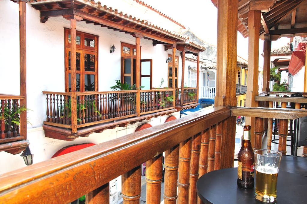 Enjoying a Club Colombia beer on the balcony of your studio apartment in the heart of the Walled City!