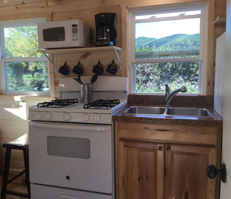 Cozy Kitchen with gas range, microwave, coffee maker