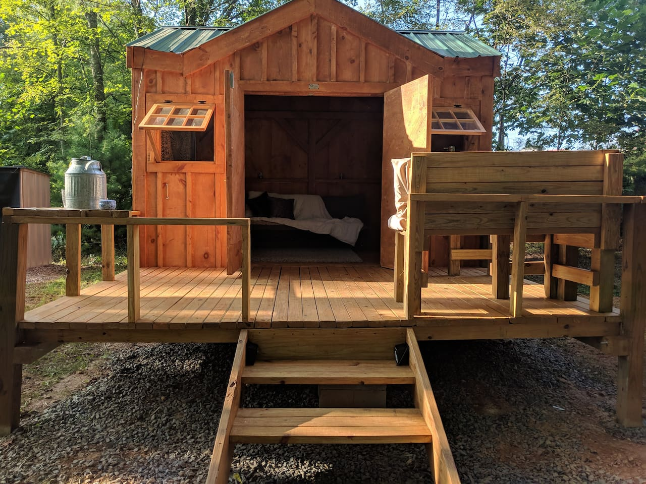 Tiny cabin with a deck. Indoor and outdoor seating. View of the pasture.