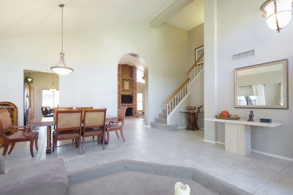 This is a very light, bright and sun filled home with vaulted ceilings and pastel decor