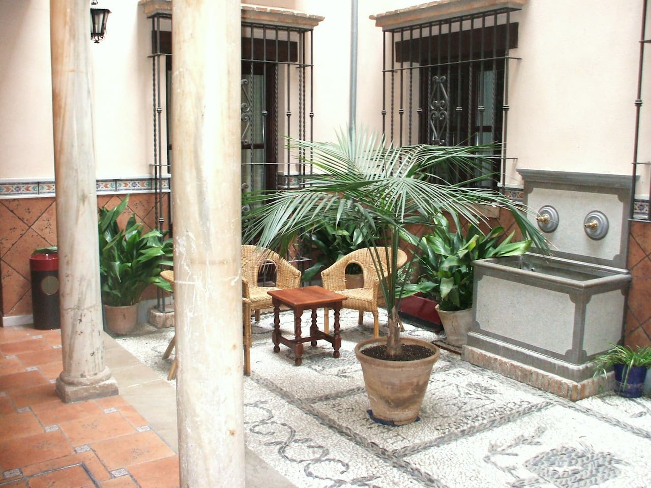 This is a typical Andalusian courtyard , with original marble pillars of the 16th century, just in the entrace to the apartment.