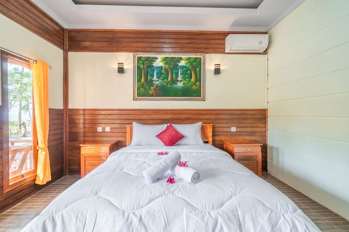 Your room is equipped with a comfy double bed, AC, Flat TV, and private bathroom.
