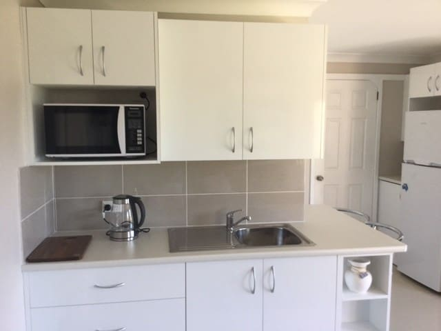 Kitchenette with Microwave oven.