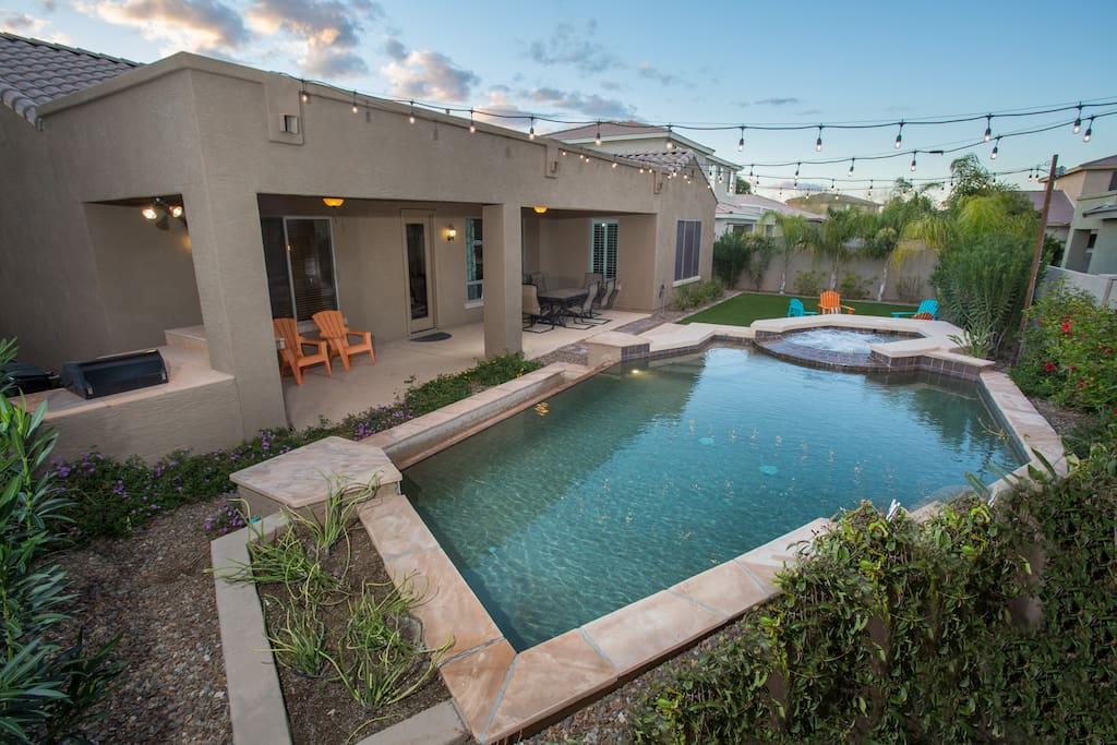 private play pool + in-ground spa, & built-in gas bbq make this yard perfect