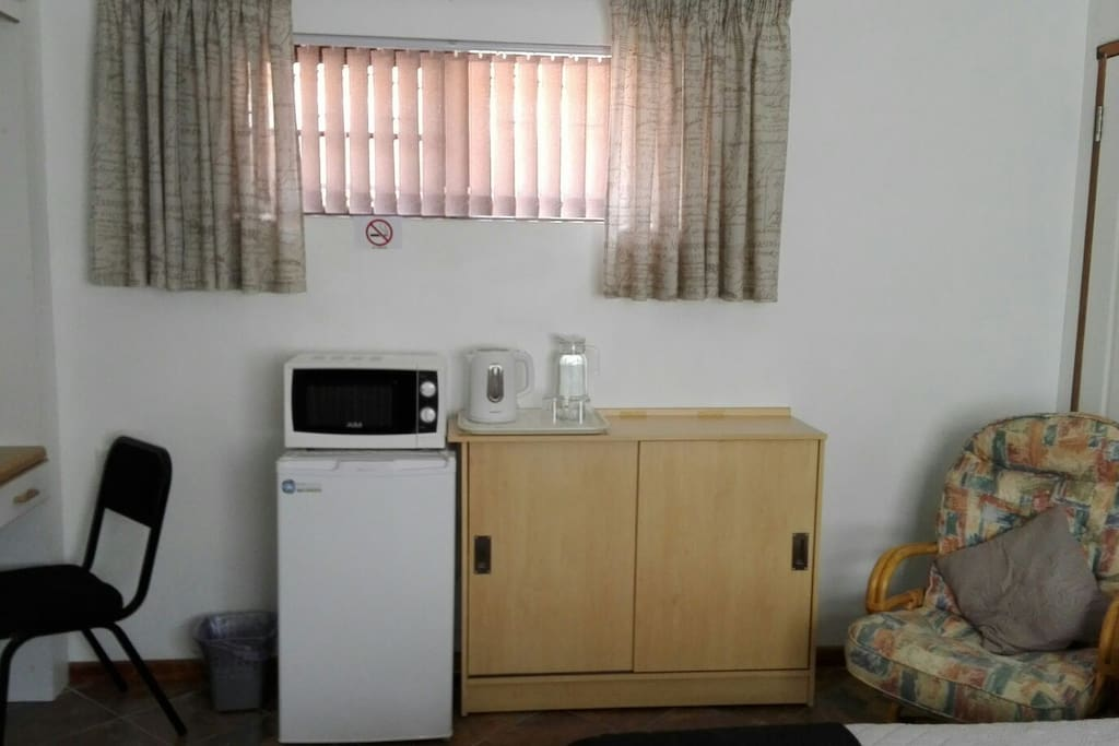 Amenities showing fridge, m/wave, kettle, cupboard for basic utensils, cutlery and crockery, and hospitality consumables.