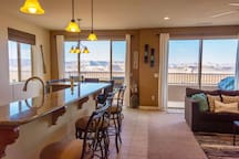 Upstairs great room has views for miles! Enjoy all of the colorful desert colors throughout the day and changing colors of the lake. A great clean and comfortable open space for entertaining with family and friends.