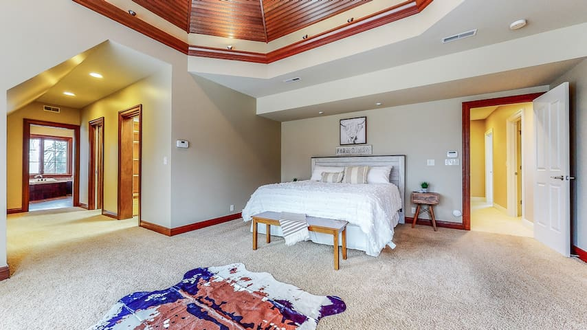 """""""Farm charm"""" master bedroom with king size bed, massive his and hers walk in closets, and en suite bathroom you'll have to see to believe. Located on the 2nd floor."""