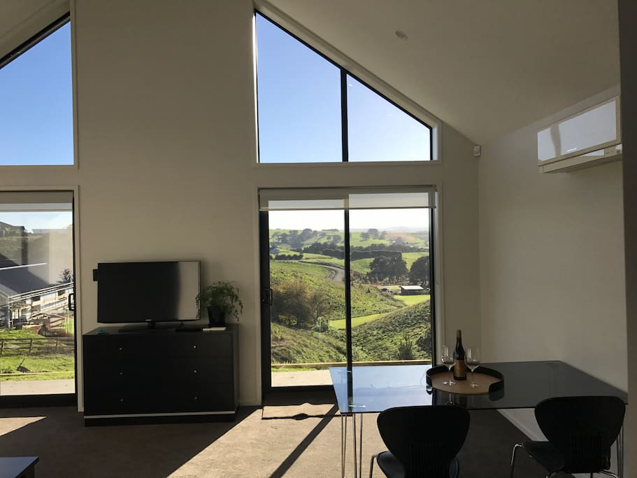 Private living/dinning room with separate entrance for guests and views of countryside