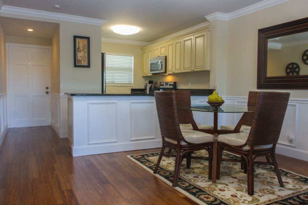 Kitchen is fully equipped with stainless steel dishwasher, range, microwave, washer and dryer