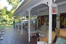 Back veranda recreation area overlooking the Tropical pool.