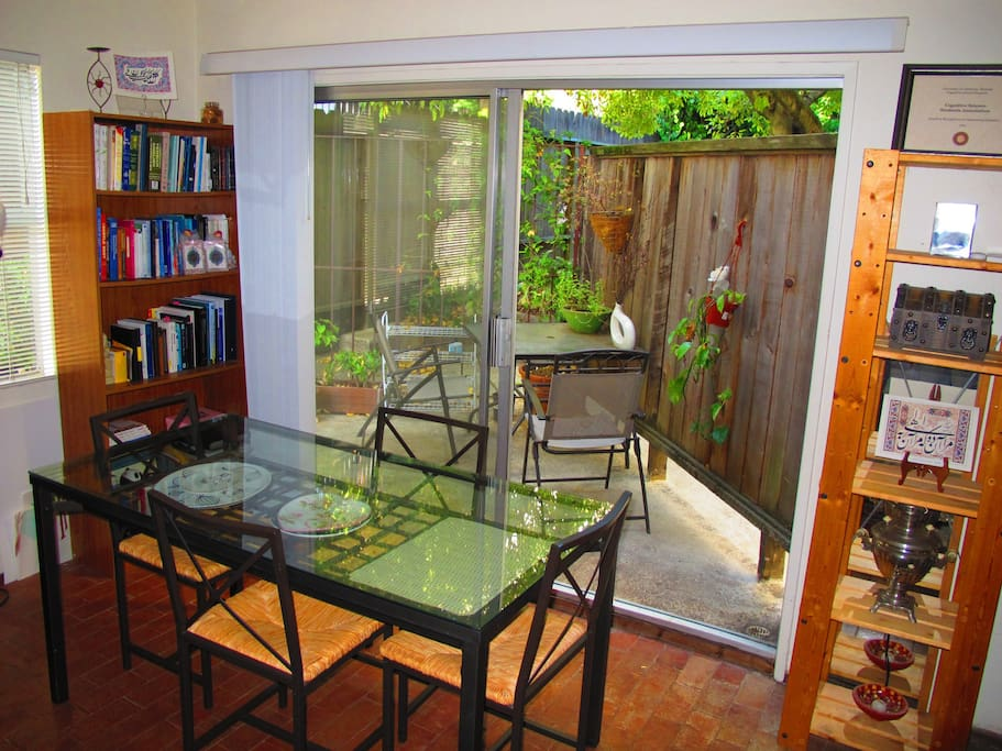 Clean dining space and cute, peaceful patio